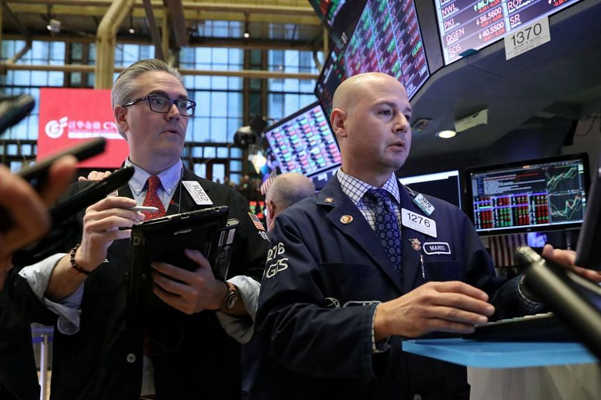Traders work on the floor of the New York Stock Exchange on Nov 8, 2018.