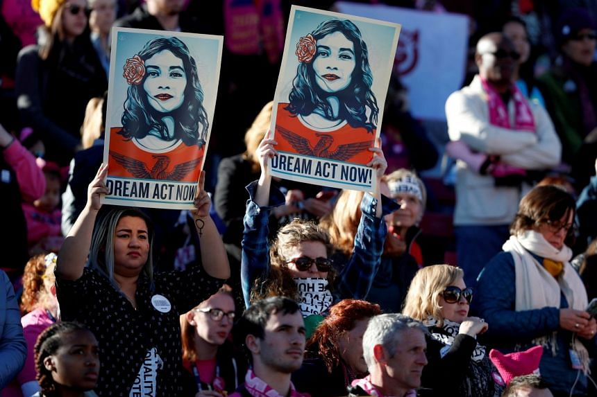Daca supporters hold signs during the Women's March in Las Vegas, Nevada, in January 2018.