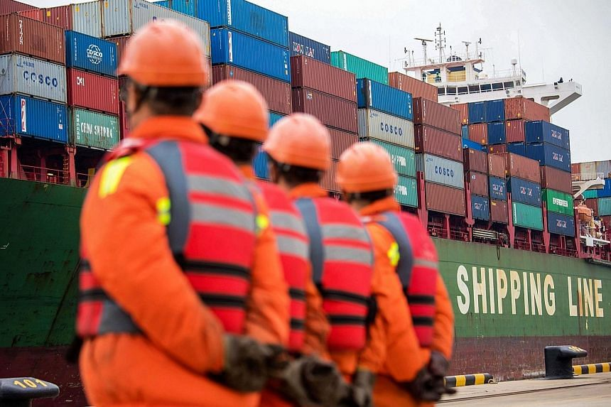A cargo ship docking at a port in Qingdao in east China's Shandong province, yesterday. Chinese exports to the US surged 13.2 per cent last month from the same period last year, according to the data released by China's Customs administration.
