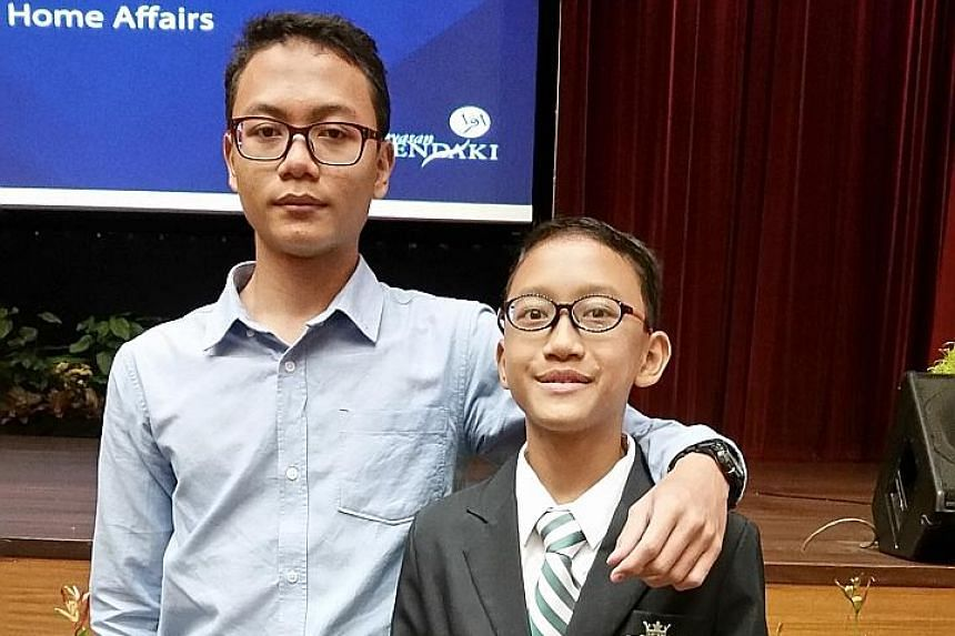 Secondary 4 student Muhammad Darwisy Iskandar, 16, and his Secondary 1 brother Muhammad Daiyan Iskandar both got into St Joseph's Institution through the Direct School Admission scheme.