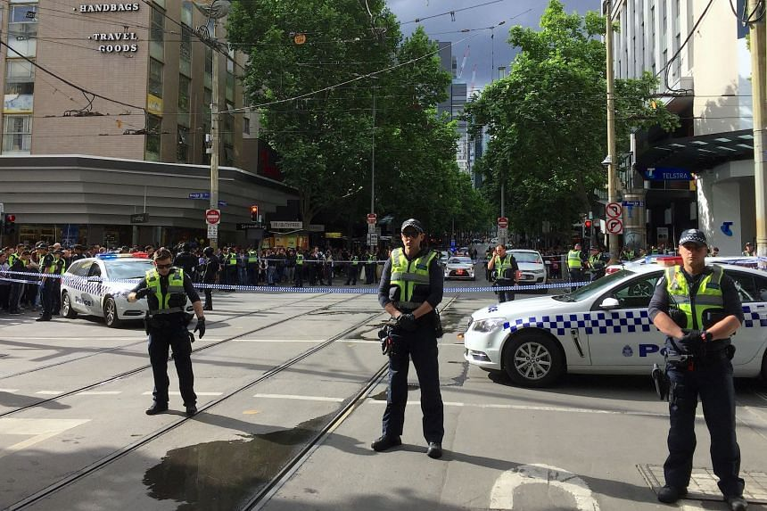 Policemen block members of the public from walking towards the Bourke Street mall in central Melbourne, Australia, on Nov 9, 2018.