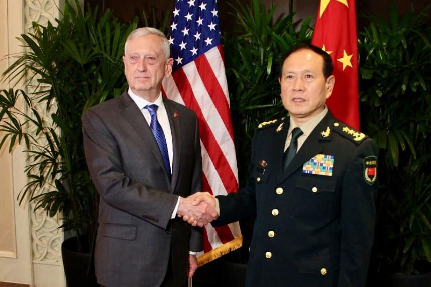 US Defence Secretary James Mattis shakes hands with his Chinese counterpart General Wei Fenghe during a meeting on the sidelines of the Asean security summit in Singapore on Oct 18.