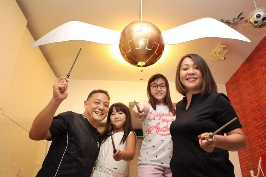 Mr Jason Teo (left) with his wife Chan Sue Li (right) and their two daughters Nicole (second from right) and Natalie (second from left), with a design called Snitch, something the family made during the last long school holidays in June.