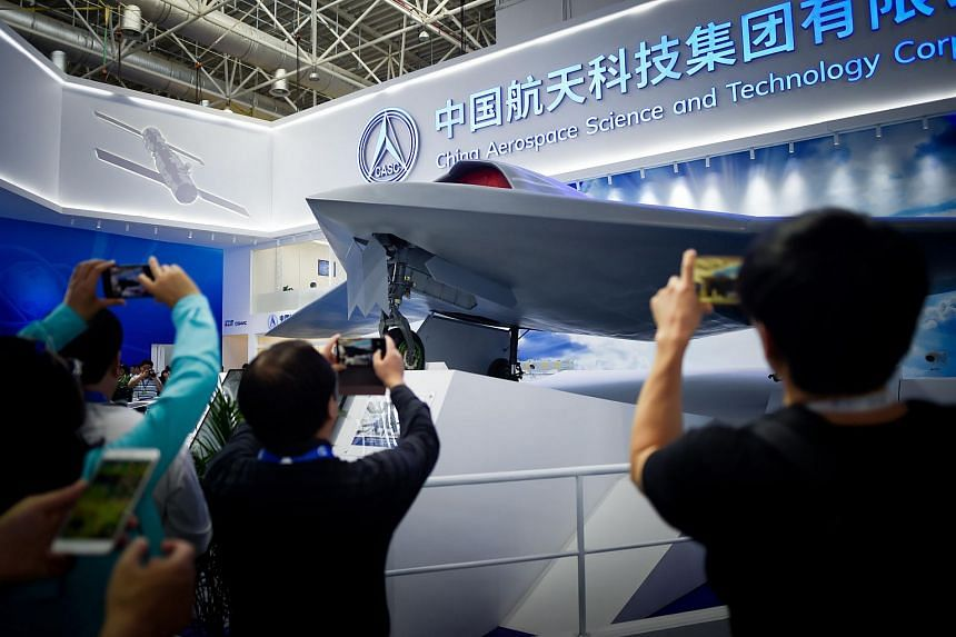 Visitors take pictures of a model of the CH-7 HALE Stealth Unmanned Reconnaissance Aircraft at the Airshow China 2018 in Zhuhai, Guangdong province, China, on Nov 6, 2018.