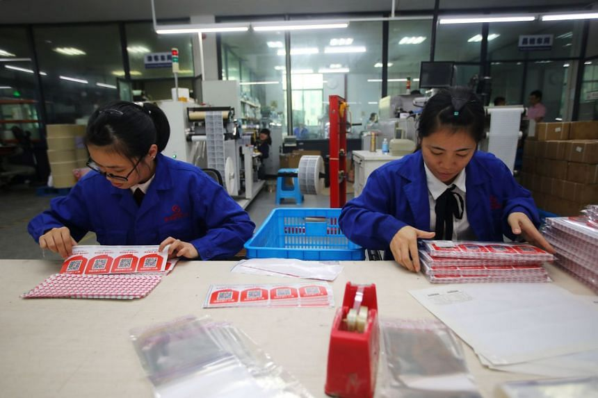 Employees work at a workshop producing QR codes ahead of the Singles' Day shopping festival, in Wenzhou, China, on Oct 24, 2018.