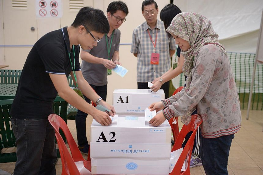 File photo of boxes being sealed at polling station located at Toa Payoh Lorong 4, on Sept 11, 2015.