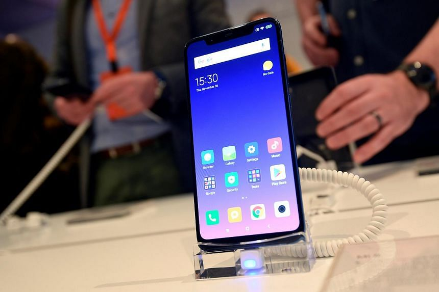 The Xiaomi Mi 8 smartphone on display at a UK launch event in London, Britain, on Nov 8, 2018.