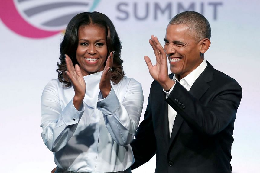 """Michelle Obama (above, with husband Barack Obama) can """"never forgive"""" Trump for questioning her husband's citizenship."""