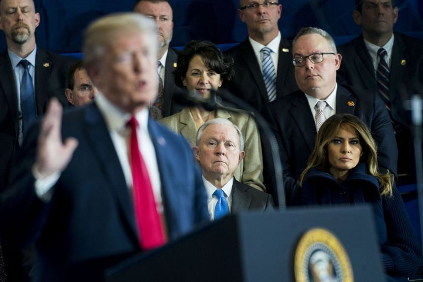 Jeff Sessions looks on as President Donald Trump speaks about US opioid addiction in March 2018.