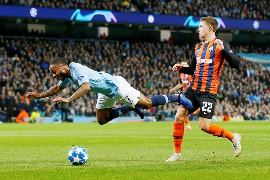 Manchester City's Raheem Sterling going down in the box in the first half of the Champions League tie against Shakhtar Donetsk on Wednesday. A penalty was awarded but he later admitted that there had been no contact from the defender Mykola Matviyenk