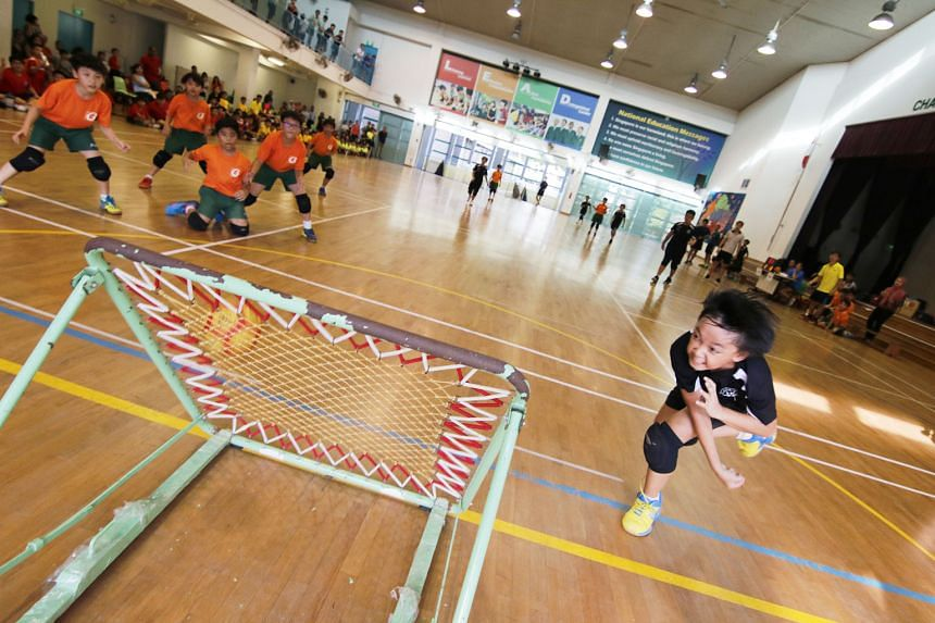 Dominic de Silva Agustus, 10, from Junyuan Primary, taking a shot in the SPH Foundation National Primary Schools Tchoukball Championships (junior division) boys' final yesterday at Farrer Park Primary. His team beat Farrer Park 7-6 to deny their oppo