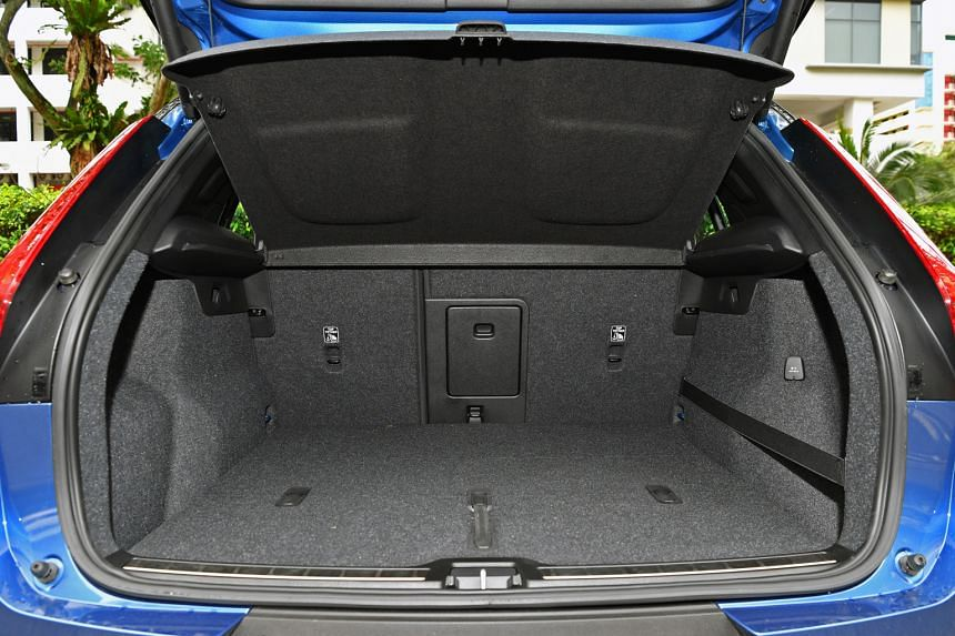 The Volvo XC40 T4 has a roomy boot (above) and its seats are supportive yet comfy.