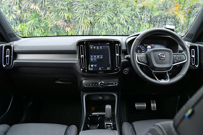 The Volvo XC40 T4 has a roomy boot and its seats are supportive yet comfy (above).