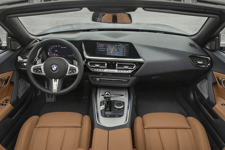 The BMW Z4 features a cabin lined with premium materials (above).