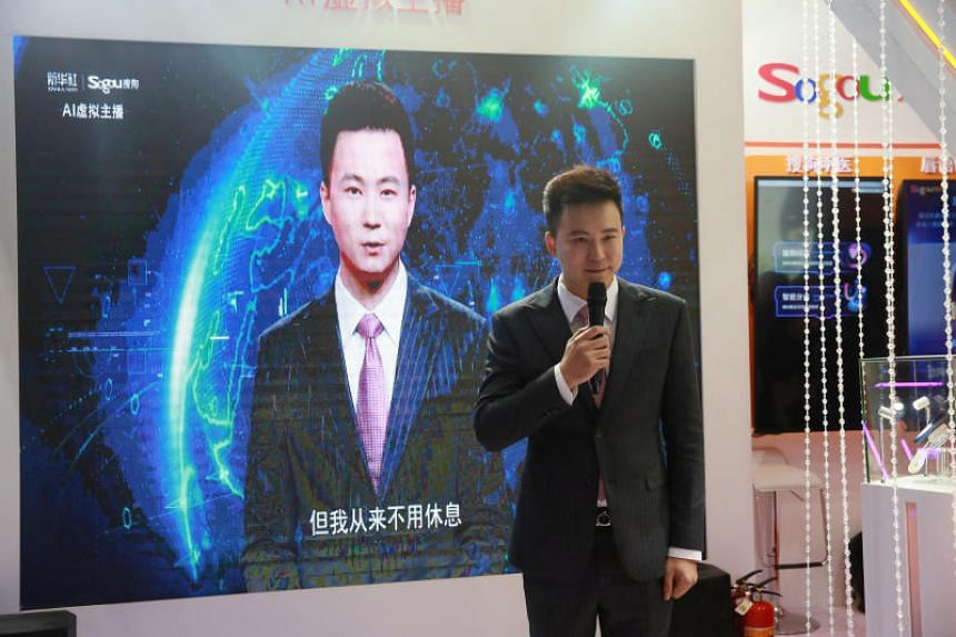 Xinhua news anchor Qiu Hao stands next to an AI virtual news anchor based on him, at a Sogou booth during an expo at the fifth World Internet Conference in Wuzhen town of Jiaxing, Zhejiang province, China, on Nov 7, 2018.