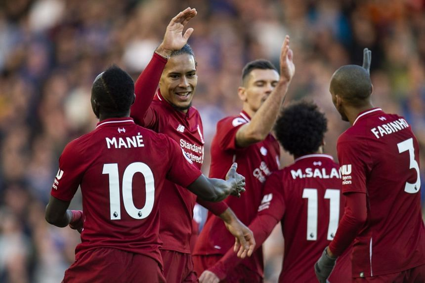 Liverpool's Mohamed Salah is congratulated by his team mates after scoring against Cardiff City at Anfield.
