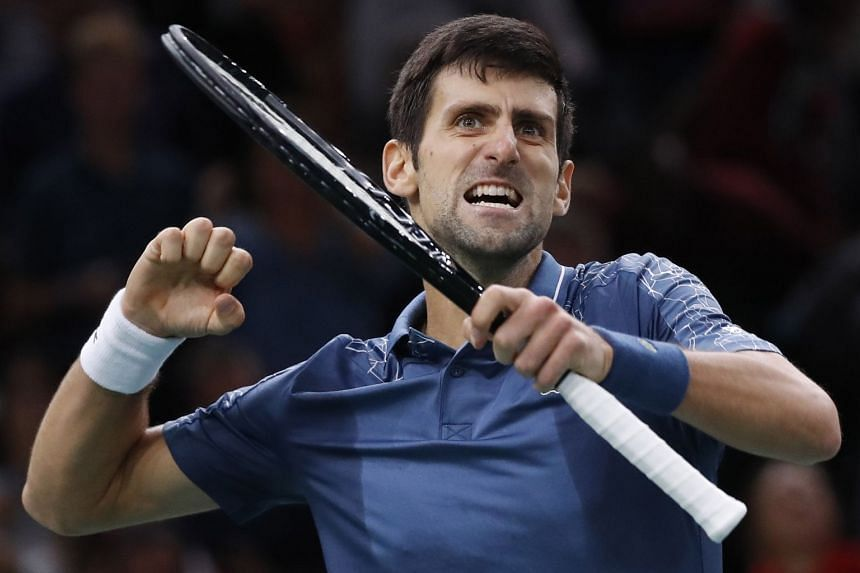 Djokovic celebrates beating Roger Federer in the semi-final of the Rolex Paris Masters.