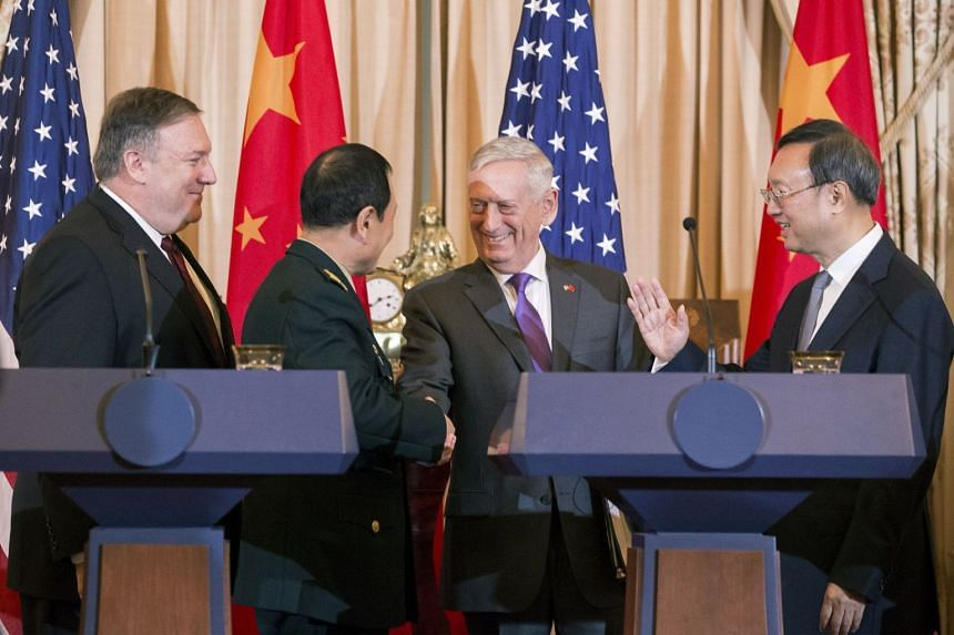Mike Pompeo (left) and James Mattis (second right) conclude a news conference with Yang Jiechi (right) and Wei Fenghe.