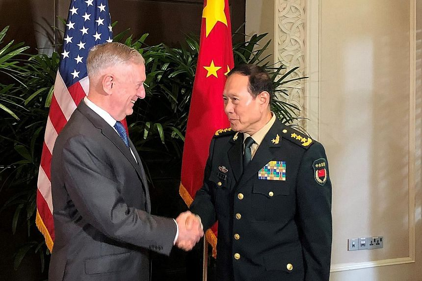 US Defence Secretary James Mattis and his Chinese counterpart, General Wei Fenghe, at a meeting in October. The two met again yesterday, for talks in Washington with other officials from both countries.