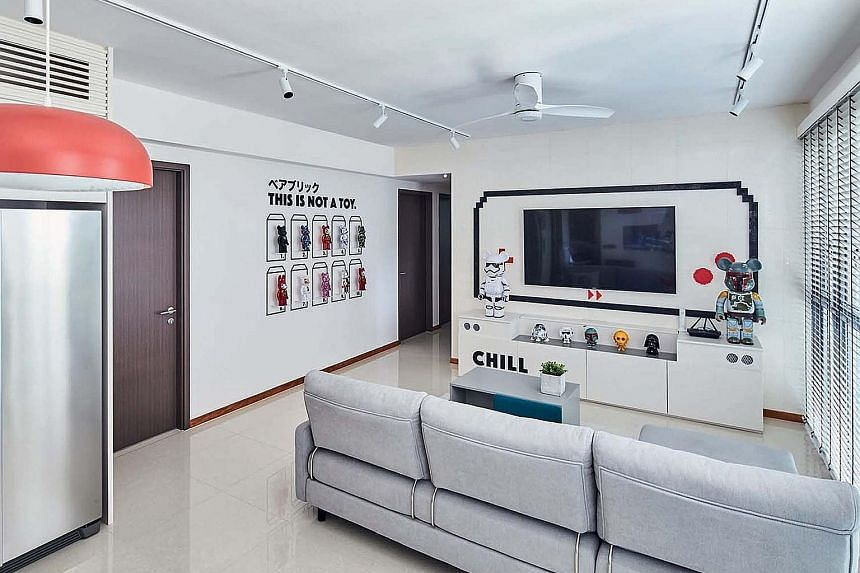 Customised cheeky his-and-hers decals in the master bedroom complement the home's mood and design. The ABC Bearbrick (No. 5) and Mika Ninagawa Sakura (No. 8, both above) toys are among the home owner's favourites. Cushions with playful prints (above