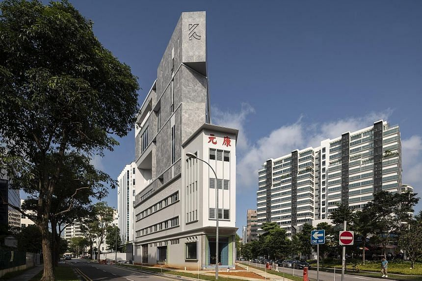 An eight-storey extension has been added to the Khong Guan Building.