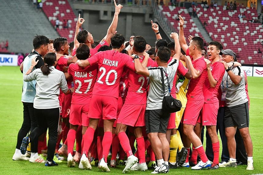 The joyous Lions after a job well done at the National Stadium last night, following their 1-0 victory over Indonesia.