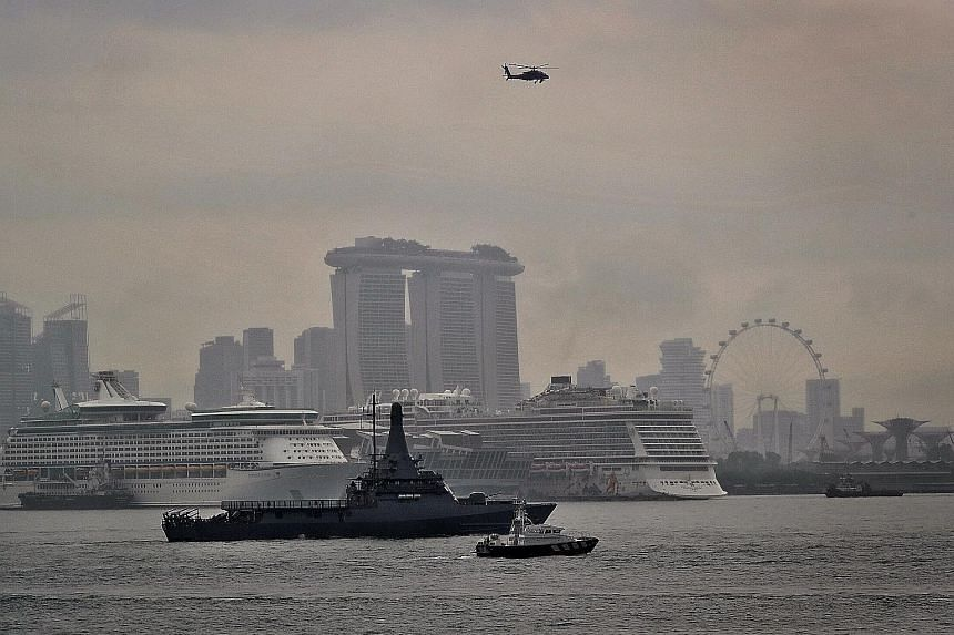 A joint patrol involving the RSS Independence, an AH-64D Apache helicopter and a Police Coast Guard boat in the anchorage off Marina Barrage yesterday. The SAF will secure Singapore's airspace and surrounding waters during the Asean Summit.