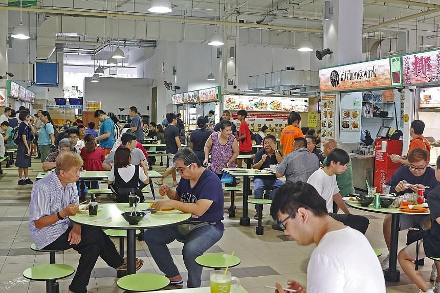 Social enterprise hawker centre operators have put in several initiatives to nurture new hawkers. At Fei Siong-run Ci Yuan Hawker Centre (left), new hawkers can rent a hawker stall for six months at half the market rate.