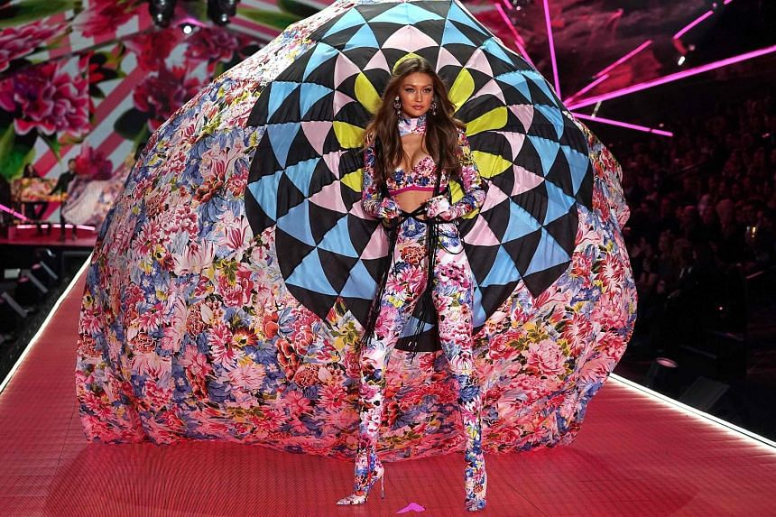 On the catwalk at the Victoria's Secret Fashion Show are models Gigi Hadid (left) and Adriana Lima (below).