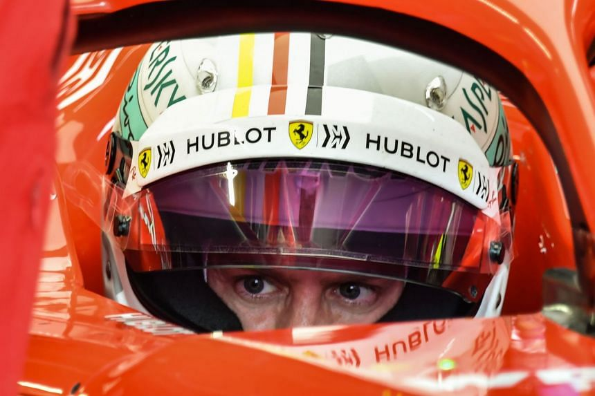 Vettel sits in his car at the pits at the Interlagos racetrack in Sao Paulo.