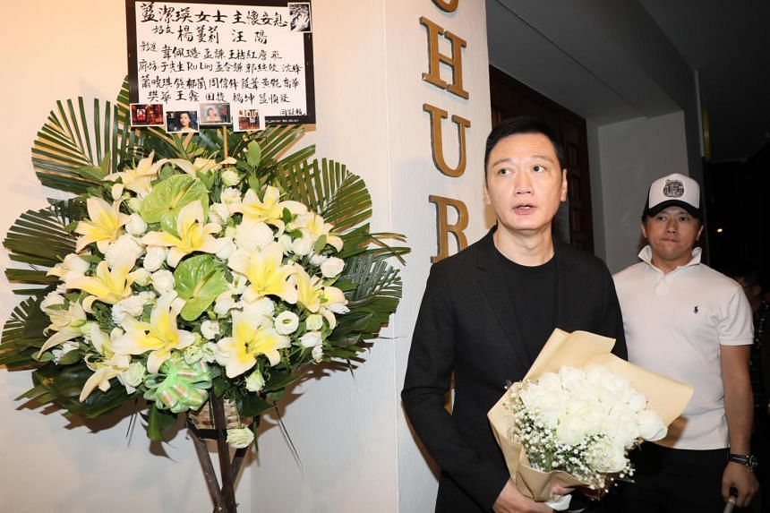 Actor Michael Tao shows up at Yammie Lam's memorial service with flowers. The two were cast mates in the TVB hit, The Greed Of Man.