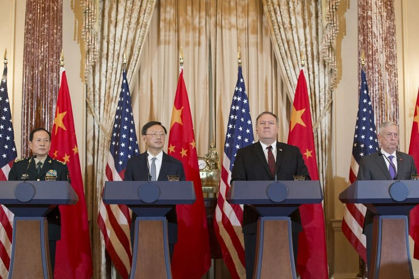 (From left) Chinese State Councilor and Defense Minister General Wei Fenghe, Chinese Politburo Member Yang Jiechi, US Secretary of State Mike Pompeo and US Secretary of Defense James Mattis hold a news conference  in Washington, on Nov 9, 2018.