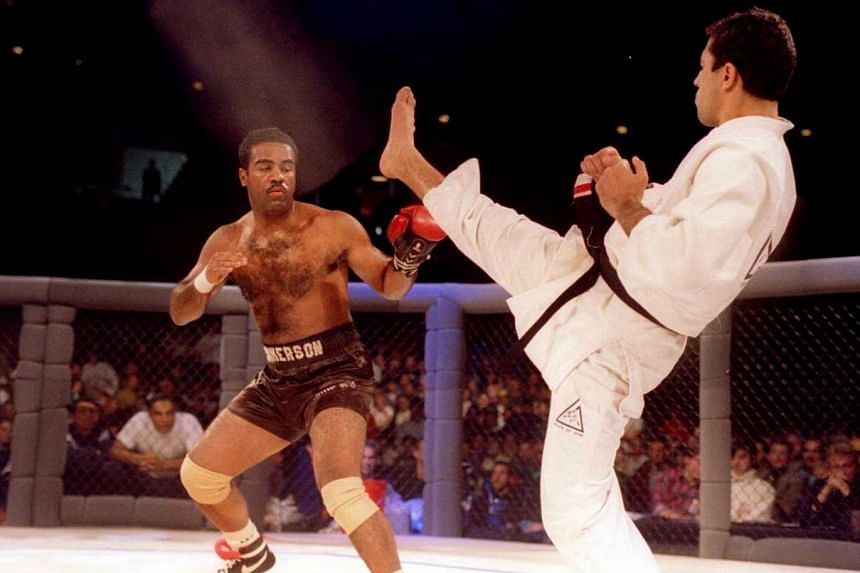 Professional boxer Art Jimmerson (left) faces Brazilian jiu jitsu expert Royce Gracie in the first UFC event, on Nov 12, 1993.