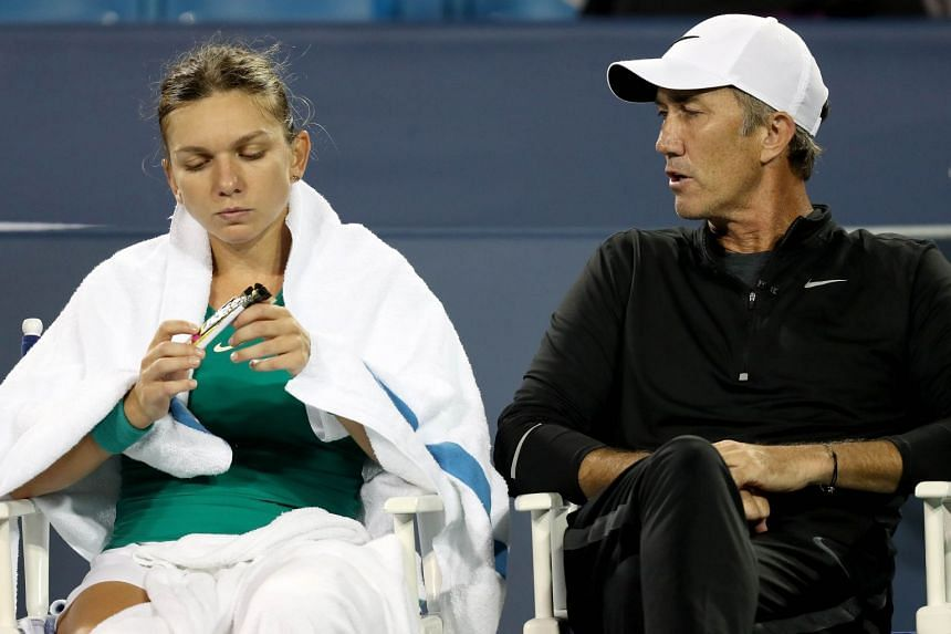Halep confers with coach Darren Cahill between sets at the Western & Southern Open.