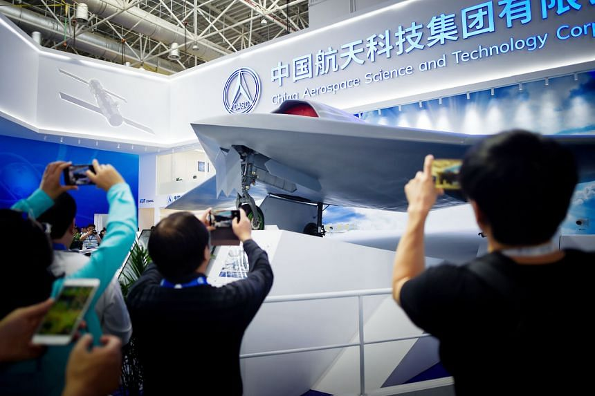 Visitors taking pictures of a stealth UAV model at Airshow China 2018 in Zhuhai this week. The show highlights China's growing production of sophisticated unmanned aerial vehicles.