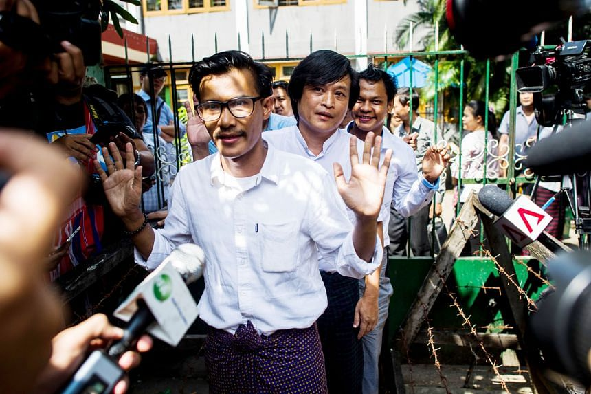 Eleven Media Group journalists Kyaw Zaw Lin (from front), Nayi Min and Phyo Wai Win leaving the court compound yesterday after the incitement case against them was withdrawn.