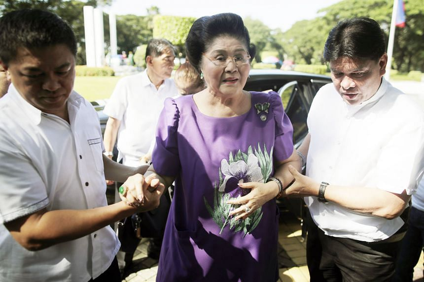 Imelda Marcos visiting the grave of her late husband, former strongman Ferdinand Marcos, at the Heroes Cemetery on Nov 1 in Taguig city, south of Manila, Philippines.