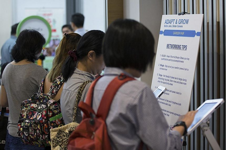 Job seekers at a job fair. Experts say that while employers will look at a job applicant's highest qualifications, skills and track record, some will still ask to see O-level scores in subjects relevant to the job.