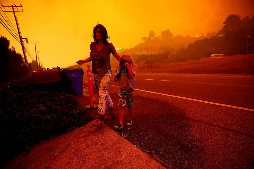 Residents Gabi and Jonah Frank walking on the Pacific Coast Highway as the Woolsey Fire threatened their home in Malibu on Friday.