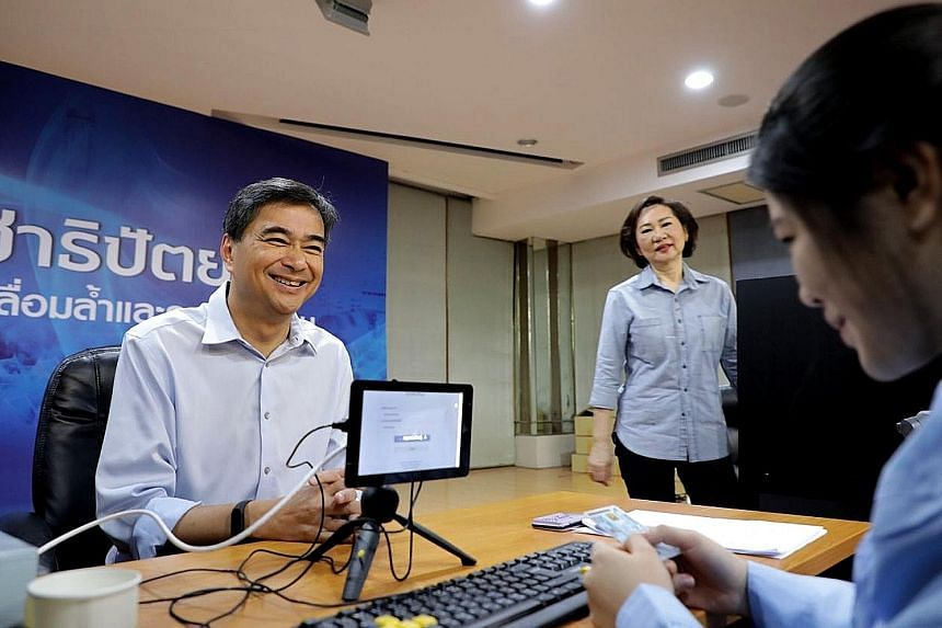 Mr Abhisit Vejjajiva taking part in the voting for the Democrat leadership at the party's headquarters last Friday. The 54-year-old won 67,505 votes out of more than 120,000 cast.