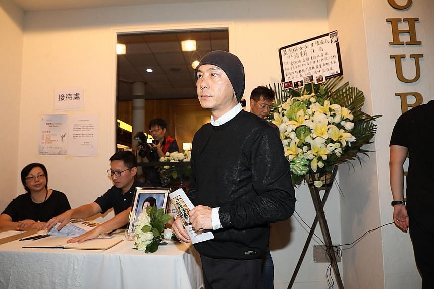 Above: Actor Dicky Cheung turned up to pay his respects and read a verse from the Bible.