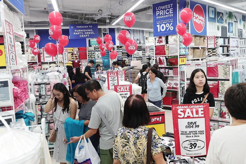 Shoppers at Spotlight's Westgate store yesterday. Nearly 300 shoppers queued outside the store ahead of its opening at 10am.