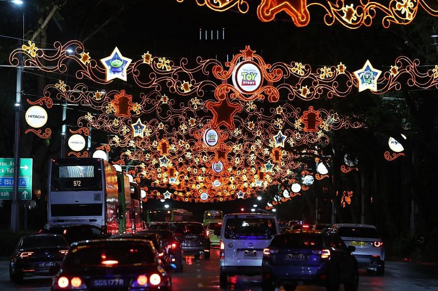 Christmas was ushered into town with the annual Orchard Road light-up ceremony held yesterday. The Disney-themed lights - sparkling in cool blue for the Frozen-themed stretch, orange for the Toy Story-themed street and turquoise for the Mickey-themed