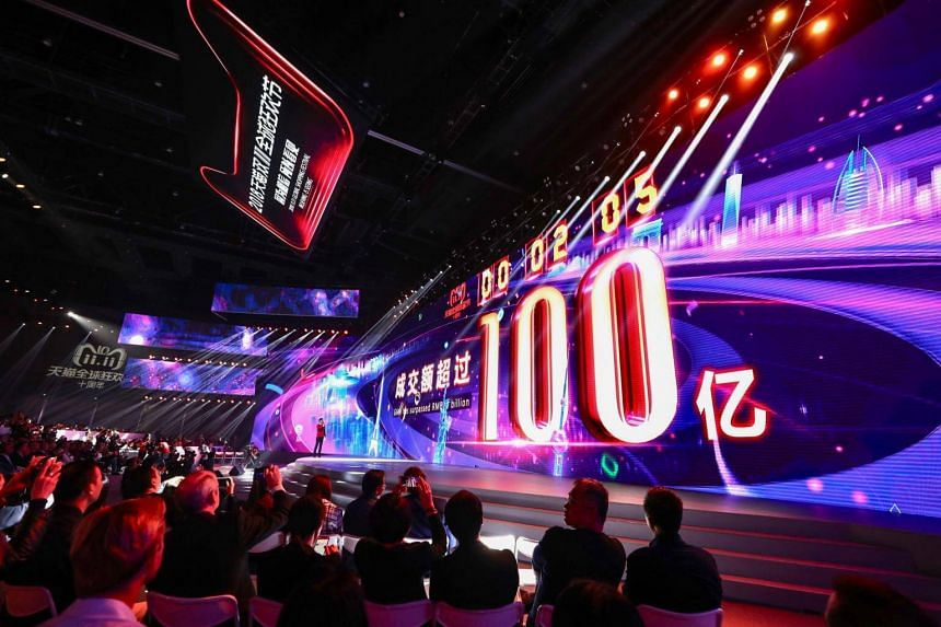 A screen displays a message indicating sales figures have surpassed 10 billion yuan during Alibaba Group Holding Ltd's annual Singles' Day online shopping event in Shanghai, on Nov 11, 2018.