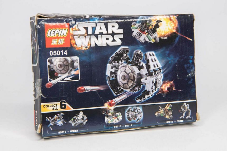 """A small Tie Fighter from the Star Wars Lego franchise costs US$2, if you are willing to overlook a slight flaw in the product's """"Lepin"""" and """"Star Wnrs"""" packaging."""