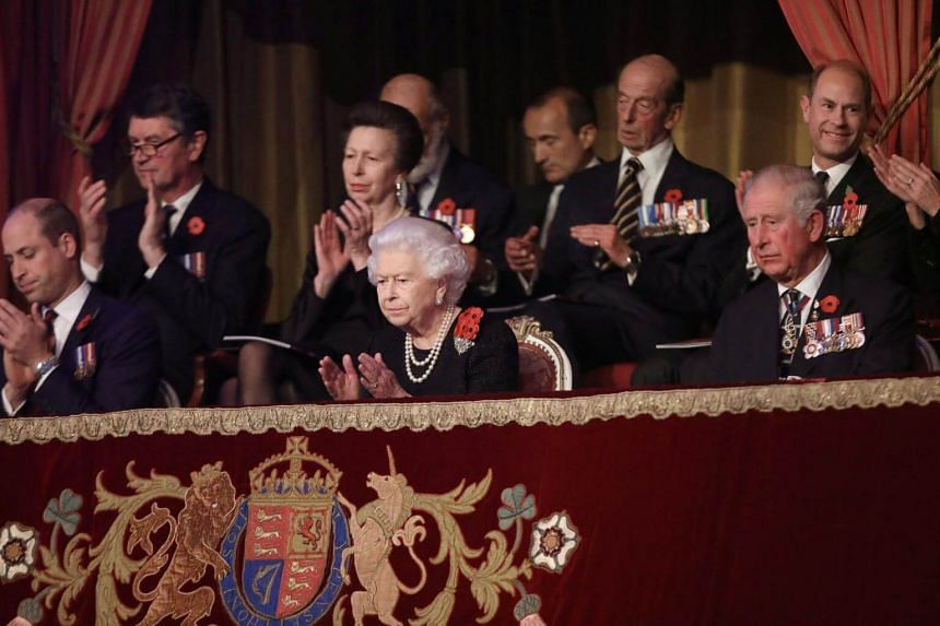 Britain's Queen Elizabeth (centre) joined her son and heir to the throne Charles, grandsons William and Harry and their wives Kate and Meghan at the Royal Albert Hall in central London at an event organised to pay tribute to all those who have died.