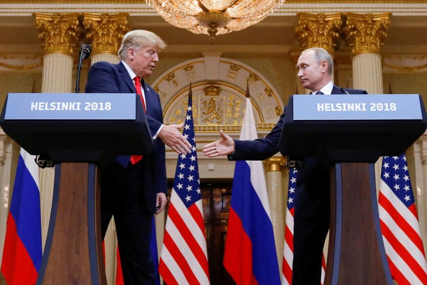US President Donald Trump and Russia's President Vladimir Putin shake hands during a joint news conference after their meeting in Helsinki, Finland, on July 16, 2018.