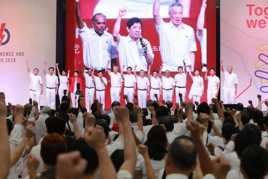 The new PAP CEC on stage, with Home Affairs and Law Minister K. Shanmugam, outgoing party chairman Khaw Boon Wan, and Secretary-General Lee Hsien Loong pictured on the large screen in the background.