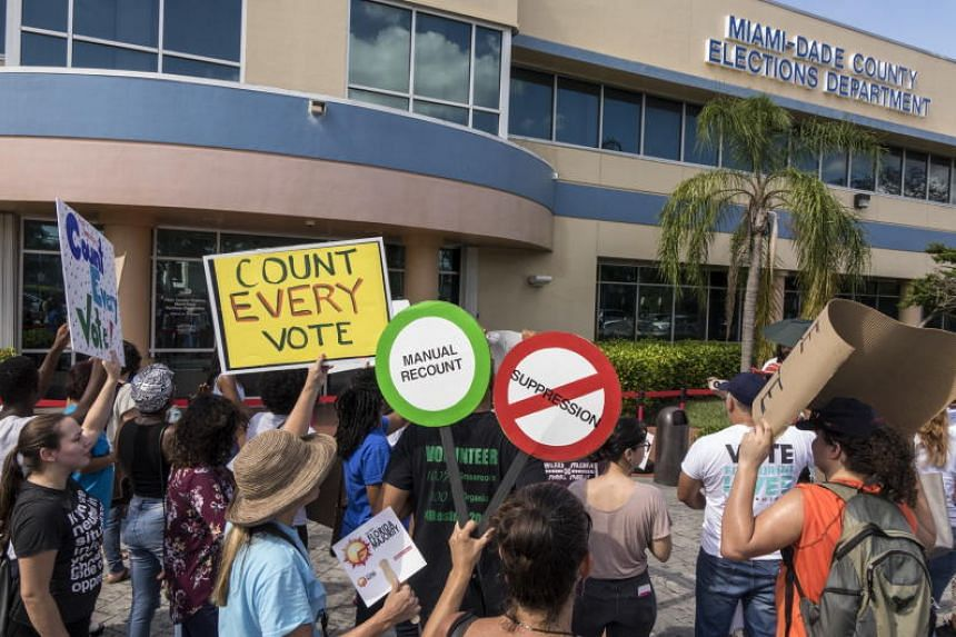 A crowd protests to demand a vote recount outside the Miami-Dade Election Department in Miami, Florida, on Nov 10, 2018.