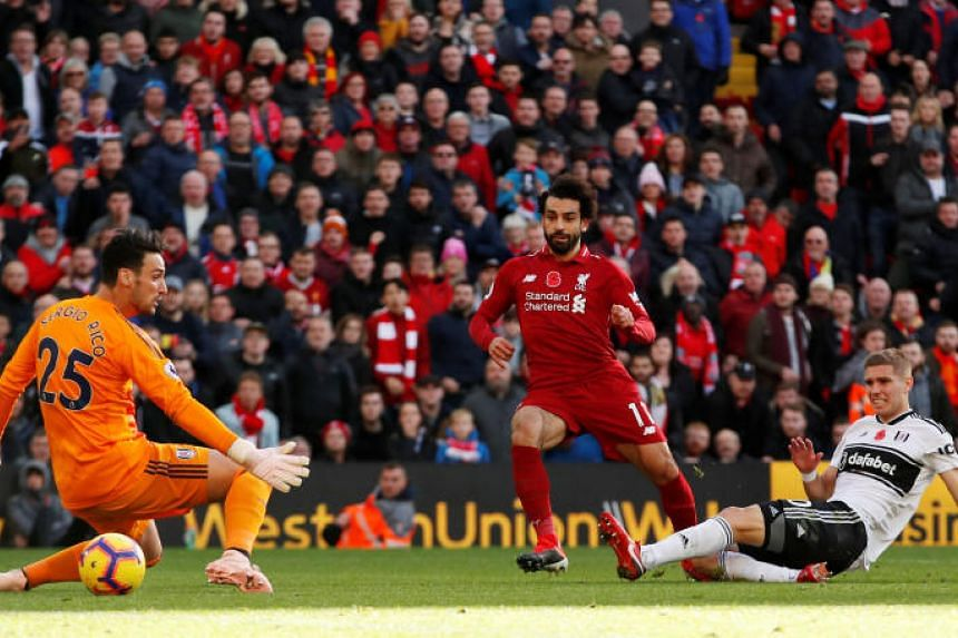 Liverpool's Mohamed Salah scores their first goal during the English Premier League match against Fulham at Anfield on Nov 11, 2018.